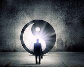 Rear view of businessman looking at yin yang sign
