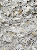 Concrete wall with pebbles