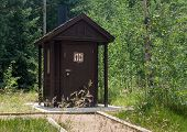 Wooden Restroom In Forest