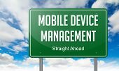 Mobile Device Management on Highway Signpost.