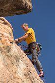 Senior Man At Top Of Rock Climb In Colorado