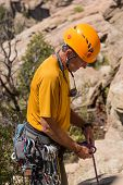 Senior Man Starting Rock Climb In Colorado