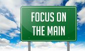 Focus on the Main in Highway Signpost.