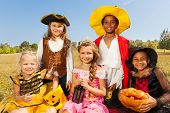 Multinational kids in Halloween costumes
