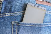 Htc Mobile Phone In A Jeans Pocket.
