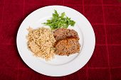 Meatloaf Rice And Arugula On Red Towel