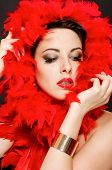 Beautiful girl in red boa with  makeup