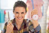Portrait Of Dressmaker Woman Showing Scissors And Pincushion