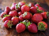 pile of strawberries on wood board