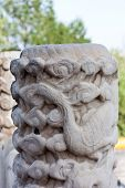 Detail Of A Stone Pillar With Phoenix In Beihai Park, Beijing
