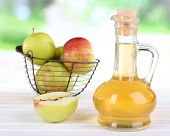 stock photo of vinegar  - Apple cider vinegar in glass bottle and ripe fresh apples - JPG