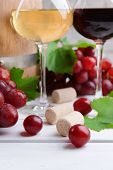 Wine with grapes on table close-up