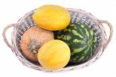 Melons and watermelons in basket isolated on white