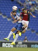 BARCELONA - AUG, 17: Giovanni Marchese of Genoa CFC vies with Christian Stuani of RCD Espanyol durin