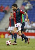 BARCELONA - AUG, 17: Mauricio Pinilla of Genoa CFC in action during a friendly match against RCD Espanyol at the Estadi Cornella on August 17, 2014 in Barcelona, Spain