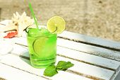 Refreshing cocktail on table, outdoors