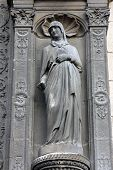 PARIS, FRANCE - NOV 11, 2012: Statue at the south portal of the church of St. Eustache in Paris, Fra