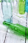 Empty glass bottles on table close-up