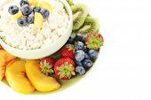 Cottage cheese with fruits and berries in bowl isolated on white