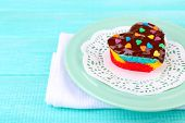 Delicious rainbow mini cake  on bright background