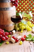 Wine with grapes on table on brown background
