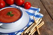 Tasty tomato soup with croutons on wooden table