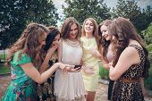 Group of girls looking at a cell phone