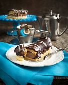Chocolate Eclairs And Cup Of Espresso