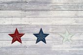 red white and blue star on wood floor