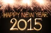 stock photo of fire  - Happy new year 2015 written with Sparkling figures - JPG