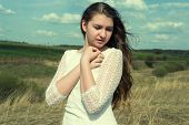 Romantic mysterious very beautiful girl on the nature on a sunny day