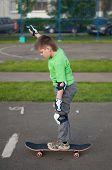 A Boy Riding A Skateboard