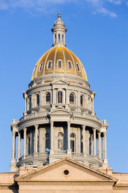 pic of granite dome  - The gold leaf covered dome of the State Capitol Dome in Denver Colorado shortly after sunrise - JPG