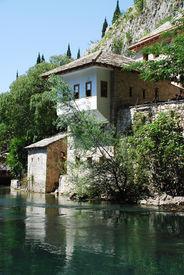 stock photo of sufi  - The historic Blagaj sufi monestary located at Vrelo Bune outside the village of Blagaj in the Herzegovina - JPG