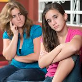 Teenager problems - Teenage girl ignoring her worried mother