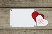 Happy Valentine's Day hearts by blank white floral sign
