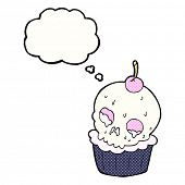 cartoon halloween skull cupcake