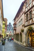 Tourists Walk To The Market Place Of Rothenburg Ob Der Tauber