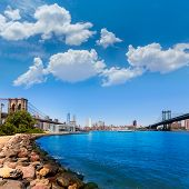 Brooklyn and Manhattan Bridges with New York city sunshine skyline US