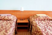 picture of motel  - bed in motel room  - JPG