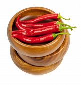 image of red hot chilli peppers  - Hot red chili or chilli pepper in wooden bowls stack isolated on white background cutout - JPG
