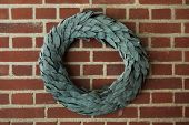 Laurel wreath on the brick wall.