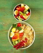 homemade granola muesli with fruit salad for breakfast