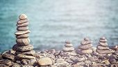 Vintage Retro Hipster Style Image Of Stones On Beach, Spa Concept Background.