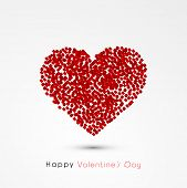 Creative red heart made by small blocks on grey background for Happy Valentines Day celebration.