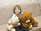 Boy With Two Toy Bears