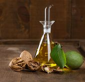 Walnut Oil In Bottle And Green With Dried Nuts