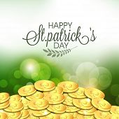 Happy St. Patrick's Day celebration with gold coins on shiny green background.