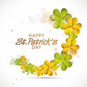 Beautiful greeting card design with green and golden shamrock leaves for Happy St. Patrick's Day celebration.