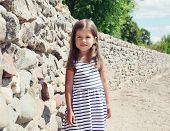 Summer, Vacation, Travel And People Concept - Pretty Little Girl Child In Striped Dress Near Seashor